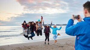 Swansea university students on the beach
